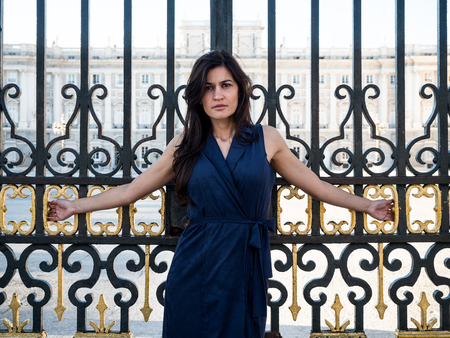 crucified: Beatiful brunette woman crucified on a palaces gate (luxurys attachment concept) Stock Photo