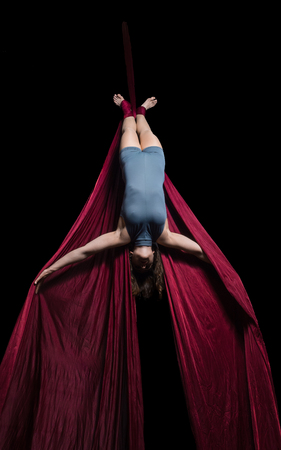 graceful: Graceful aerial dancer woman doing her performance isolated on black