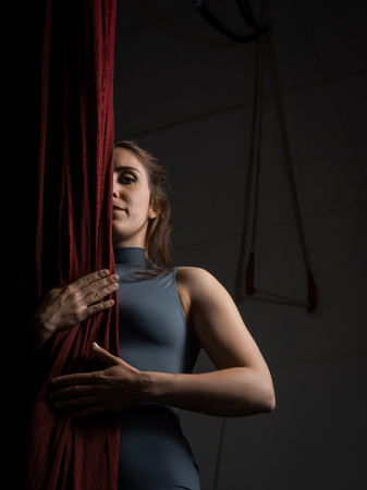 Portrait of an aerial dancer woman focused on her performance at the circus