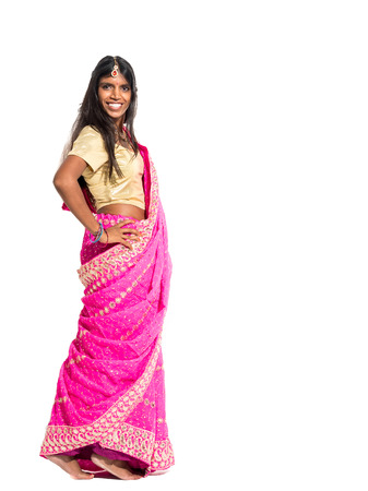 bindi: Beautiful young indian woman dancing Bollywood and wearing a traditional sari isolated on white background
