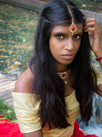 Close up portrait of a beatiful and young traditional indian woman with nice eyes