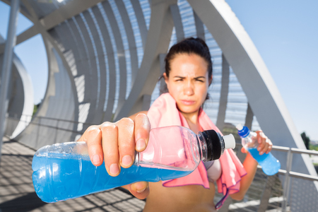 hydration: Female runner with energetic drinks for hydration. Recovery concept