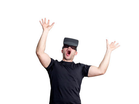 immersion: Amazed man using virtual reality glasses isolated on white background. Technology immersion concept.