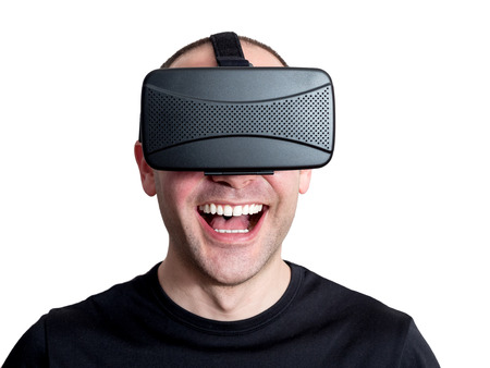 immersion: Man laughing using virtual reality glasses isolated on white background. Technology immersion concept.