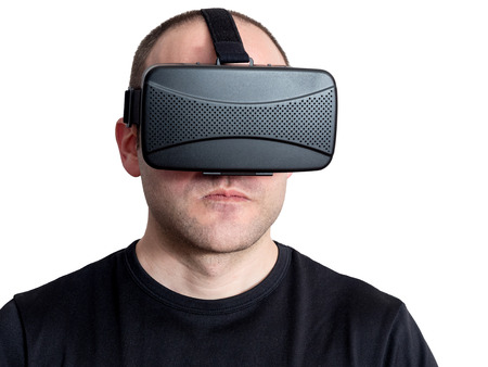 tough man: Angry and tough man using virtual reality headset isolated on white background. Technology immersion concept.