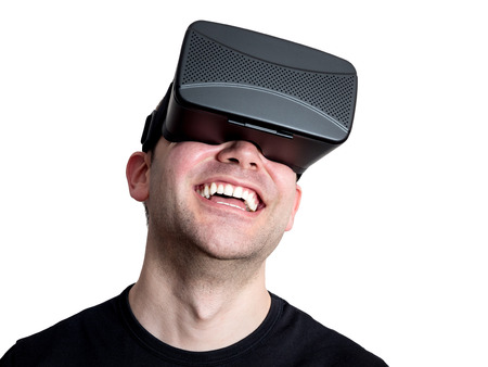 immersion: Happy man using virtual reality glasses isolated on white background. Technology immersion concept.