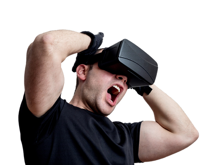 Man screaming using virtual reality headset isolated on white background. Technology immersion concept.