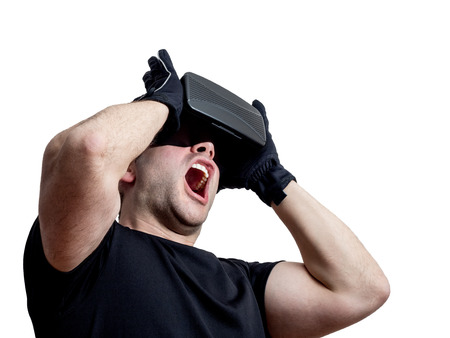 immersion: Man screaming using virtual reality headset isolated on white background. Technology immersion concept.