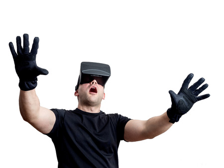immersion: Fascinated man using virtual reality glasses isolated on white background. Technology immersion concept.