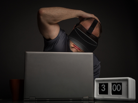 insanity: Tired man addict to technology and virtual reality with insomnnia. Technology addiction and mental disorders concept.