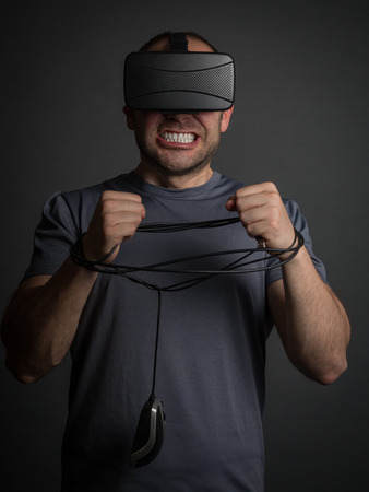 dependency: Technology and video games addiction and modern mental illness. Anxiety and dependency for technology. Stock Photo