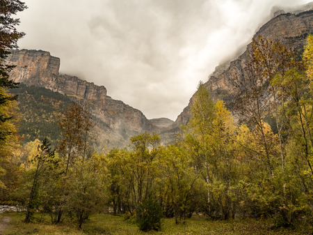 ordesa: Cloudy and stormy valley in autumn in Ordesa National Park