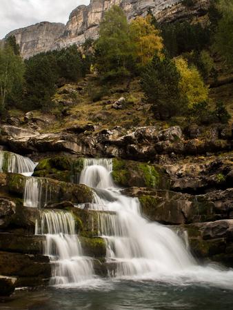 ordesa: Waterfall in Pyrenees mountains in autumn (Ordesa, Spain)
