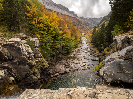 ordesa: Cloudy and rocky canyon in autumn in Ordesa National Park (Pyrenees, Spain) Stock Photo