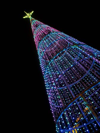 iluminated: Christmas tree at night in the city isolated on black Stock Photo