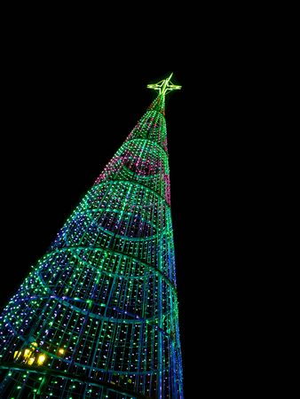 Christmas tree at night in the city isolated on black Stock Photo