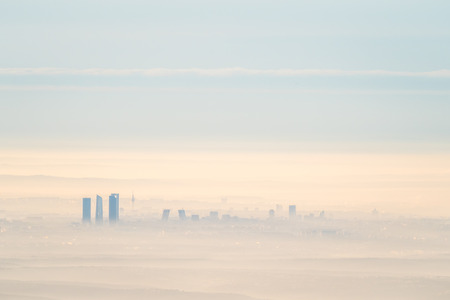 lejos: Far aerial cityscape of Madrid city with fog in the morning. Artistic picture