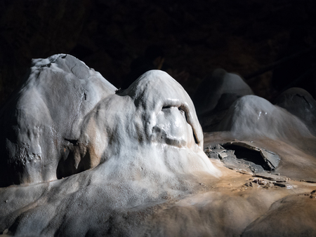 Stalagmite in a Valporqueroscave with ghost shape in Leon (Spain)