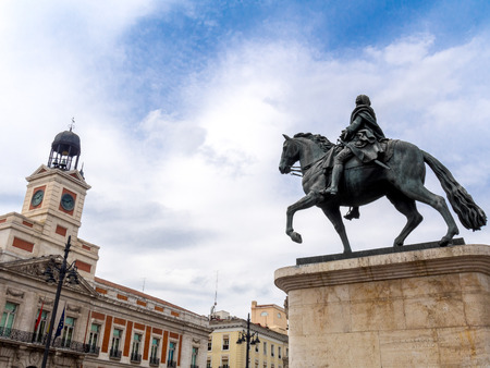 Puerta del Sol square in Madrid, with Casa de Correos at the left and the equestrian statue of Carlos III at the right
