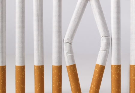 Some cigarettes imitating a prison with bars  You can stop smoking Stock Photo