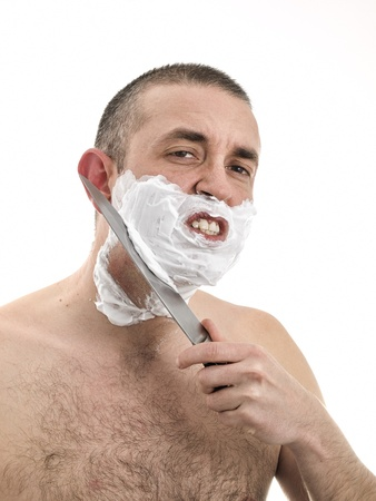 Man shaving with a knife  He has irritated skin and a lot of pain