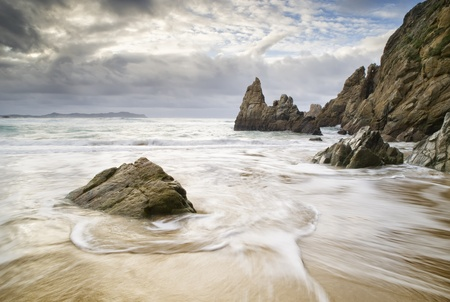 Beach with water and rocks  The picture was taken on a beach in Galicia, Spain  photo