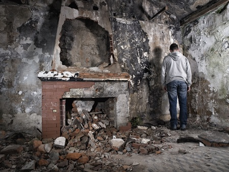 giving back: Man giving back in ruins