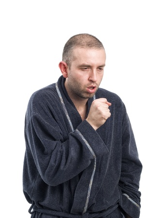 coughing: Sick man coughing on white background. The man has a cold or other illness.
