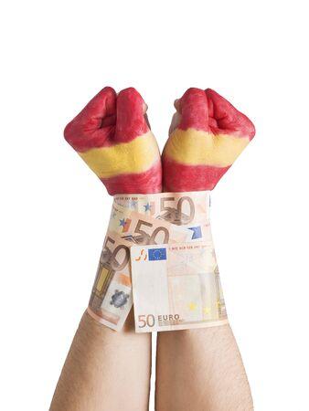 cuffed: Dos manos pintadas bandera de Espa�a y esposado con billetes de 50 euros. La imagen se pretende transmitir el concepto de la crisis econ�mica espa�ola que est�n experimentando la presi�n, as� como los mercados y los bancos de Espa�a y su gente.
