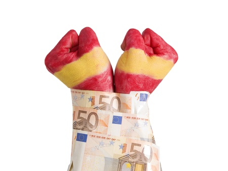 cuffed: Two hands painted flag Spain and cuffed with 50 euro notes. The picture is intended to convey the concept of the spanish economic crisis we are experiencing the pressure as well as markets and banks over Spain and its people. Stock Photo