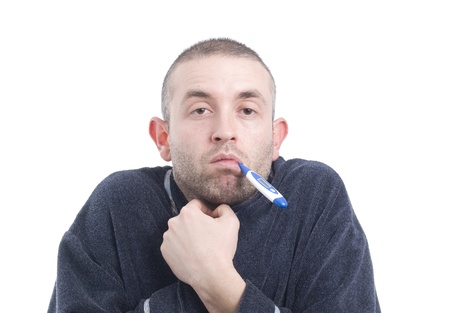 Sick man with thermometer on white background. A normal man, no model. Standard-Bild
