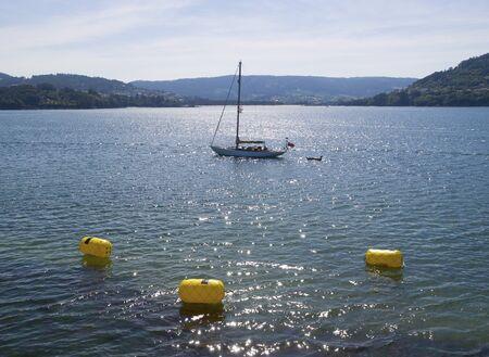 buoys: sailboat at sea with three buoys.