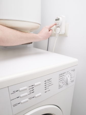 Timer to save energy for domestic purposes and one person programming. The photo also shows a washer