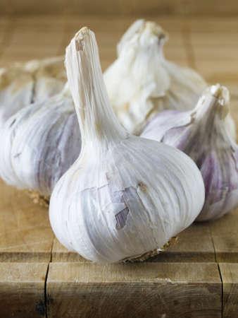 garlics: Garlics on a wooden table