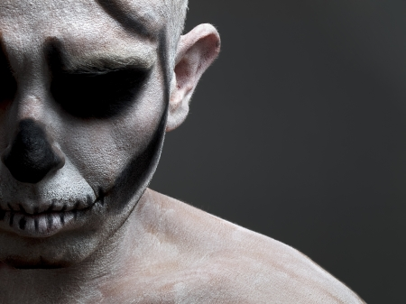 face painted with a skull