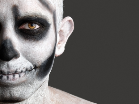 face painted with a skull  The photo shows a young man with painted face face painted with a skull Stock Photo - 15783035