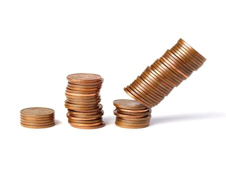 Three stacks of coins 5-cent increase in height and isolated on white background  One of the stacks of coins falling photo