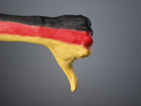 expressing negativity: Hand painted with the flag of Germany,  expressing negativity and isolated on gray background