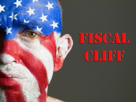 Man with his face painted with the flag of USA and the expression fiscal cliff