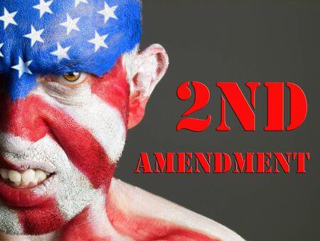 amendment: Hombre con la cara pintada con la bandera de EE.UU. Concepto Segunda Enmienda expresi�n agresiva