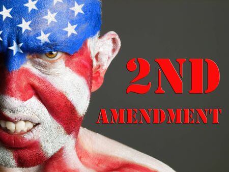 amendment: Man with his face painted with the flag of USA  Second Amendment aggressive expression concept  Stock Photo