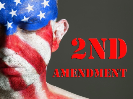 amendment: Man with his face painted with the flag of USA  Second Amendment expression concept