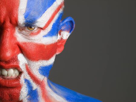 Man with his face painted with the flag of United Kingdom photo