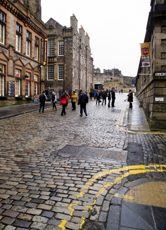 EDINBURGH, SCOTLAND-JANUARY 20  Royal Mile street in Edinburgh, Scotland, on January 20, 2012  Royal Mile is one of the most important streets of Edinburgh, In background we can see the famous Edinburgh Castle