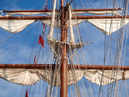 furled: Mast of a ship with furled sails detail