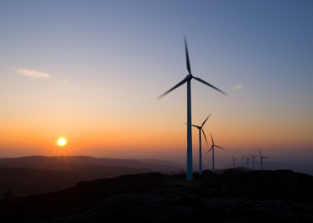 Wind turbines at sunset in a galician landscape