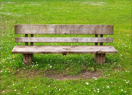 timber bench seat: Wooden park bench in nature  A good place to sit