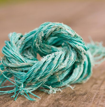 deteriorated: Deteriorated piece of string in a macro detail  Stock Photo