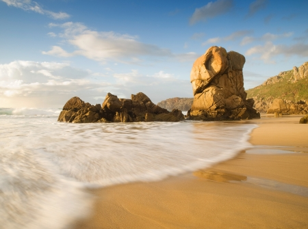 Lumeboo beach in Galicia, Spain  A beautiful beach with a wave in the foreground