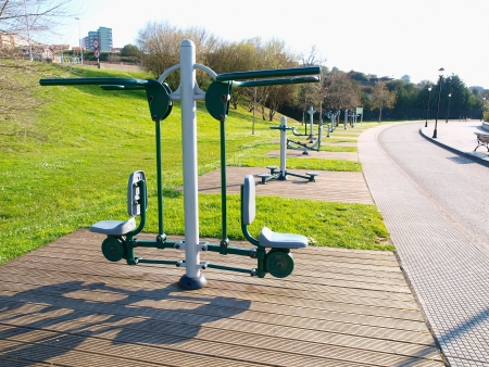 Exercise equipment in a public park in a sunny day
